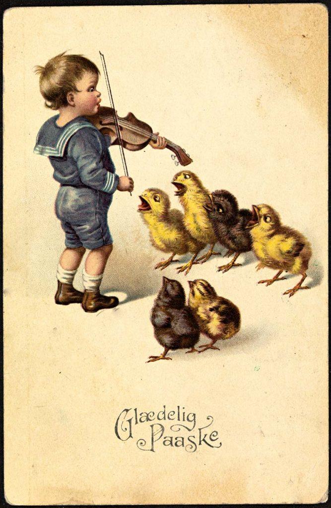 Boy playing violin to chicks_1922