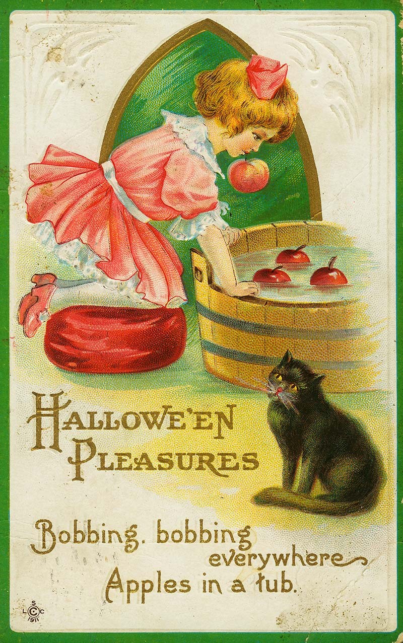 Vintage image of young girl bobbing for apples