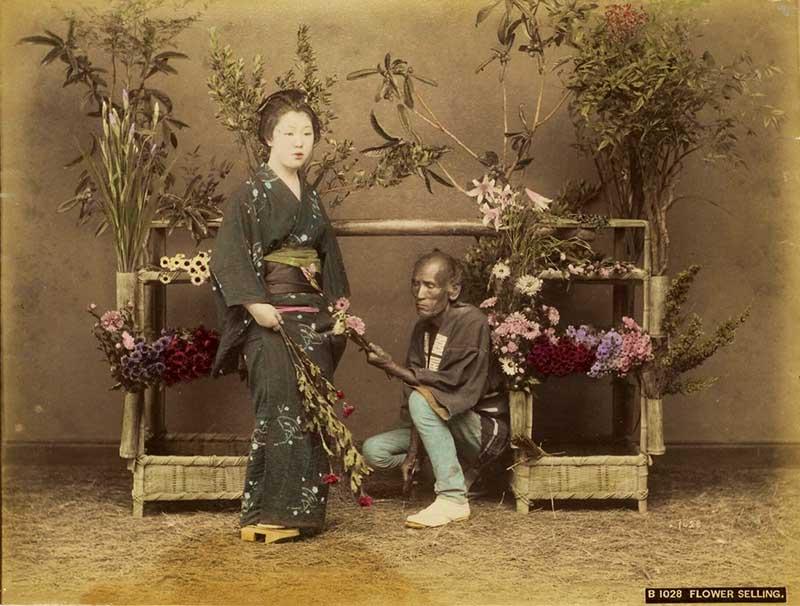Kusakabe Kimbei selling flowers