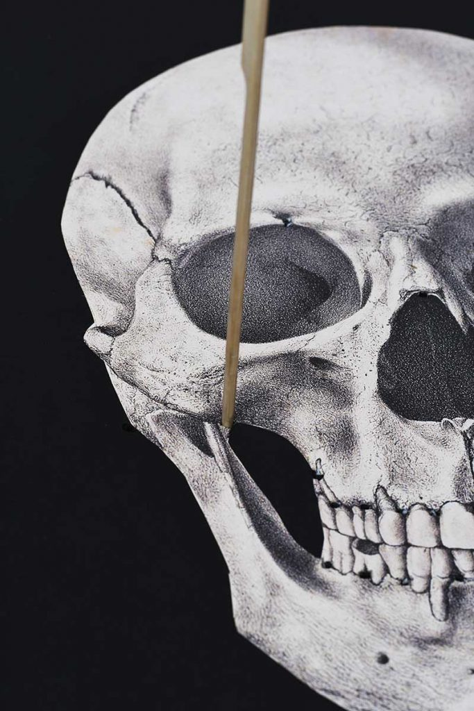 Punching holes in skull