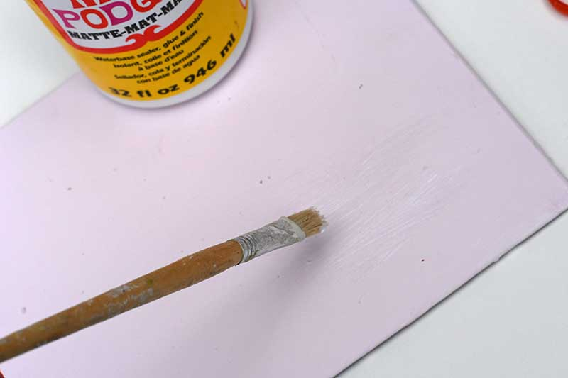 pasting glue on tablemat