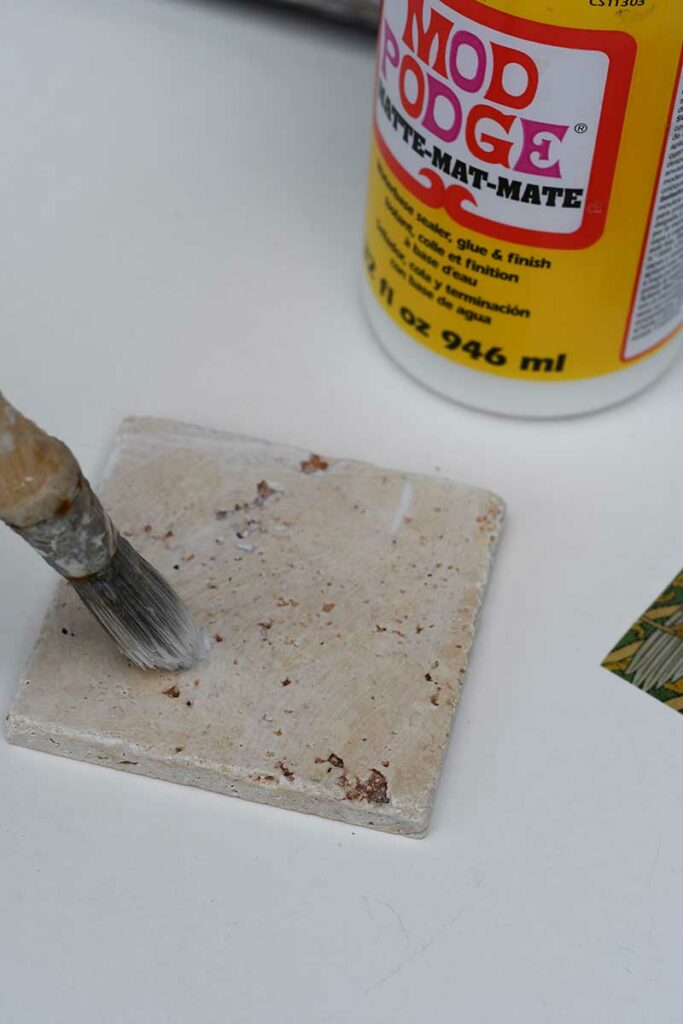 Pasting the ceramic tile with Mod Podge