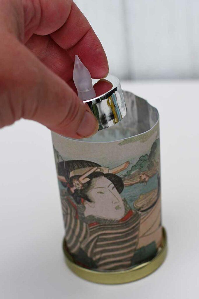 adding tea light to lantern